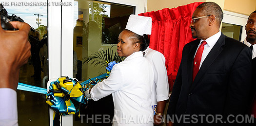 Hubert Minnis-Nurses of the Grand Bahama Health services cut ribbon
