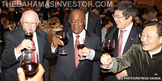 Prime Minister Hubert Ingraham joins in with a toast