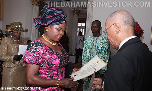 Laraba Elsie-Bhutto (left) presents her Letters of Commission