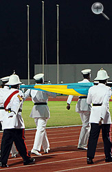 The Royal Bahamas Police Force carry the national flag at the opening ceremony.