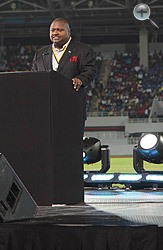 Sports Minister Charles Maynard addresses the audience.