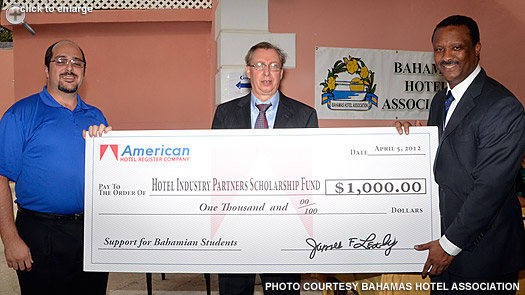 American's director for sales presents the Hotel Industry Partners Scholarship Fund contribution
