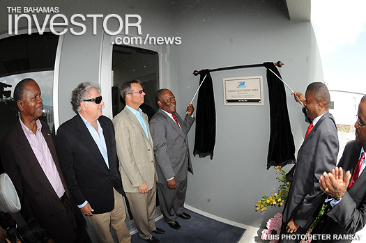 Prime Minister Hubert Ingraham and State Minister of Finance Zhivargo Laing unveil the plaque to officially open the new Nassau Container Port at Arawak Cay