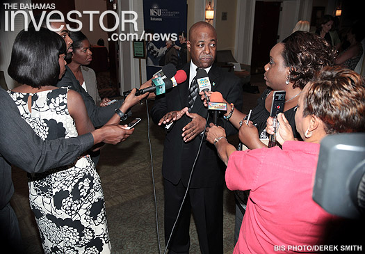 Minister of Tourism Obie Wilchcombe speaks to members of the press