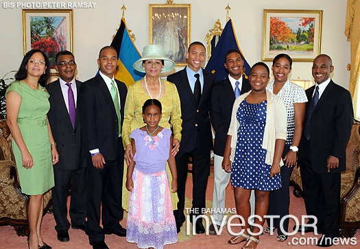 pictured with her children and grand children in the Drawing Room at Government House