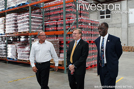 Minister of Financial Services Ryan Pinder takes a tour of the new Coca-Cola plant