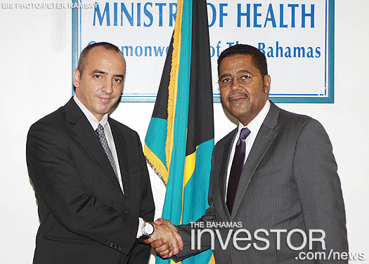 Minister of Health Perry Gomez welcomes Ernesto Soberon Guzman