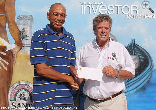 James Sands (left) presents a cheque to Sheldon Gibson