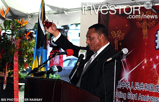 Prime Minister Perry Christie raises his glass