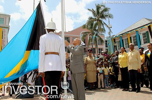 Governor General Sir Arthur Foulkes raises the flag