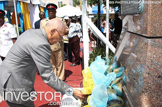 Governor General Sir Arthur Foulkes lays a wreath