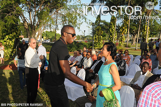Rose Marie Davis, wife of Deputy Prime Minister Philip Davis, greets Jamaican track star Usain Bolt