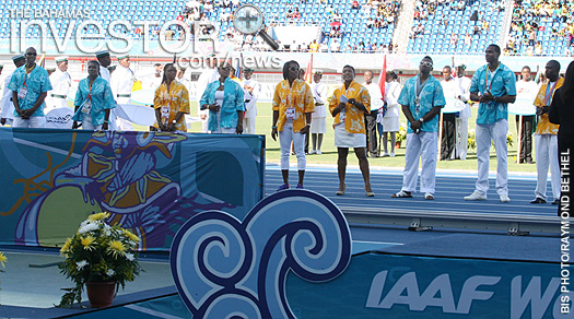 Bahamian Elite Athletes line the track during the opening ceremony