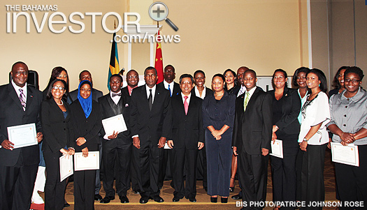 Cabinet ministers, senior government officials and stakeholders pose with the Bahamians who received scholarships to attend university in the People's Republic of China