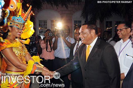 Prime Minister Christie greets a dancer