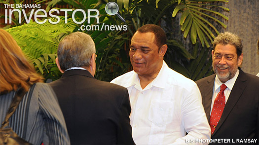The Prime Minister (centre) is greeted by Raul Modesto Castro Ruz