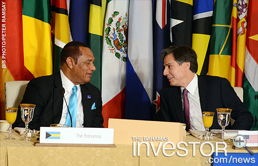 Prime Minister Perry Christie, left, in discussion with the United States deputy secretary of state Anthony Blinken