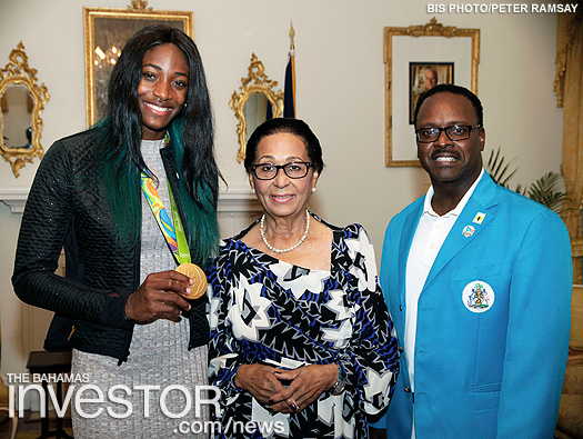 Shaunae Miller, Dame Marguerite Pindling, and Minister of Youth, Sports and Culture Dr Daniel Johnson